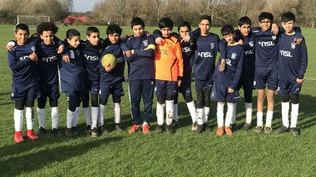 FC Leytonstone under-13s face the camera