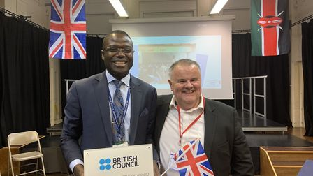 Nelson Primary School teacher Daniel Okiya with John Rolfe from the British Council. Picture: Beth D