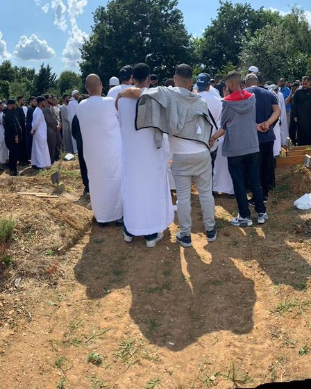 Friends and loved ones united at Fuadi's funeral after his body was released by the coroner. Picture