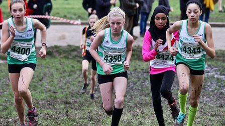 Woodford Green under-13 girls L to R: Tilly, Molly and Abigail hit the hill at speed at the Met Leag