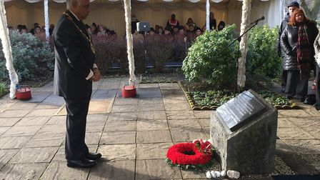 Redbridge Mayor Cllr Gurdial Bhamra laying a wreath at Valentines Park Holocaust Memorial Garden. Ph