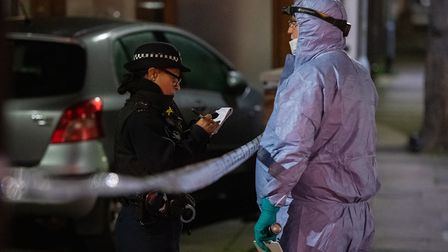 Police at the scene of a triple stabbing in Elmstead Road. Picture: PA