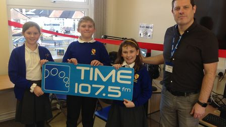 Time FM's Mark Dover with children on launching the radio. Picture: Joseph Fielder.
