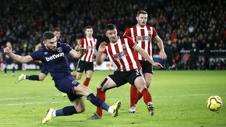 West Ham United's Robert Snodgrass (left) scores his sides first goal before VAR rules it as invalid