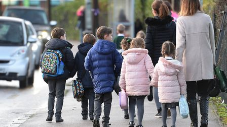Parents walk their children to school. Picture: Nick Ansell/PA Wire
