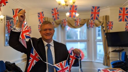 Andrew Rosindell gets ready to celebrate the big day in the Conservative headquarters. Picture: Adri