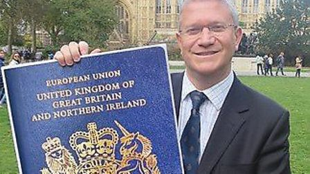 Andrew with a mock-up of a blue passport. Picture: Andrew Rosindell