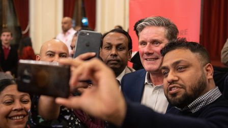 Labour leadership candidate Sir Keir Starmer poses for photos after speaking at the Old Town Hall, S