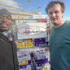 Joel from Newham Foodbank and Lee from Expedient Security with just some of their donation