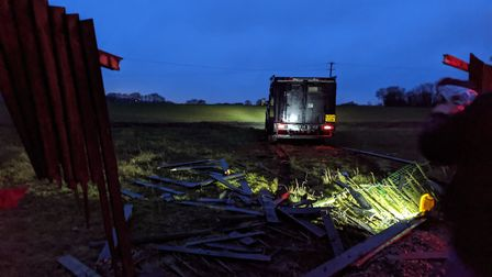 In order to break down the locked iron gate into the Navestock farm site, police used an armoured tr