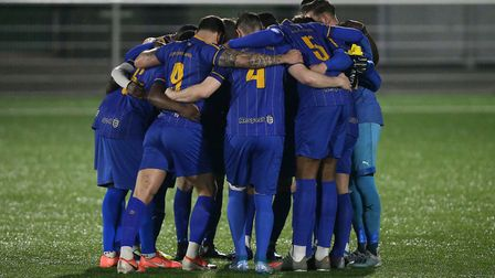 Romford players huddle during Romford vs AFC Sudbury, BetVictor League North Division Football at Pa