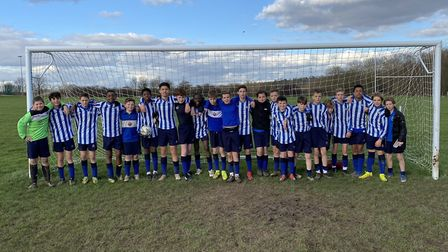 Emerson Park Academy's year eights face the camera