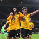 Wolverhampton Wanderers' Romain Saiss (left) celebrates scoring his side's first goal of the game wi