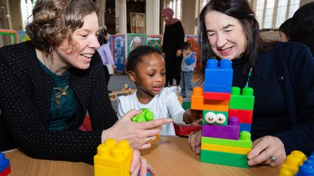 Cllr Julianne Marriott and Cllr Jane Lofthouse play with a child during the visit to Kool Kidze. Pic
