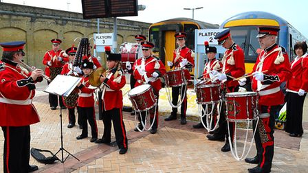 People came together to celebrate the Queen's 90th birthday at Lowestoft train station. Picture: Mic