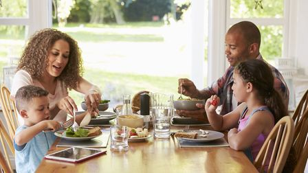 Enjoy eating dinner together as a family in your new conservatory. Picture: Getty Images