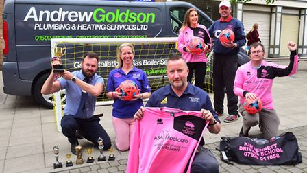 Cancer Charity Lauren Lou are presented with football goal, trophies and football shirt by Andrew Go