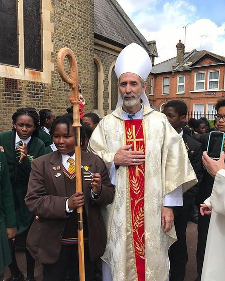 Bishop of Brentwood Alan Williams SM with schoool children from St Bonaventure's and St Antony's at