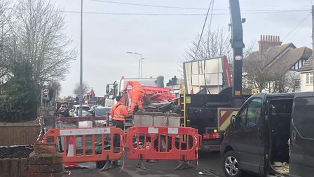 Work crews from Transport for London were removing the damaged bus stop in Squirrels Heath Road, Har