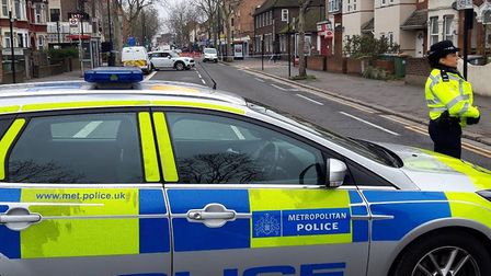 A police cordon is in place after a woman was stabbed near the junction of Barking Road and Altmore