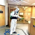 The Manor Park family disinfecting an office this week. Picture: Phillipa Haines
