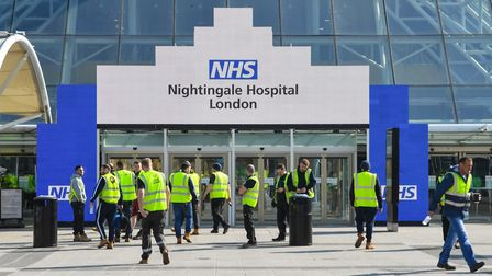 Workers outside the entrance of the ExCeL. Picture: Stefan Rousseau/PA Wire