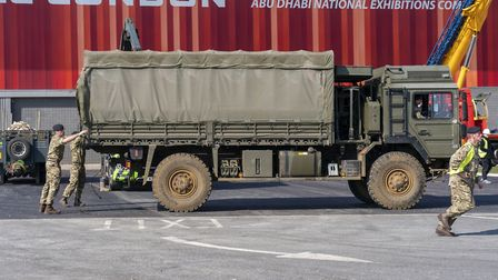 Soldiers unload a truck at the ExCeL, which is being made into a temporary hospital. Picture: Stefan