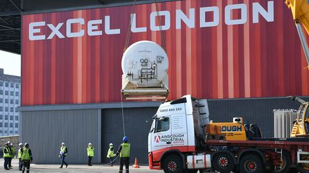 A liquid oxygen tank is lifted by a crane at the ExCeL. Picture: Stefan Rousseau/PA Wire