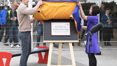Natalie Grey, head of nursing at NHS Nightingale Hospital, unveils a plaque on behalf of the Prince