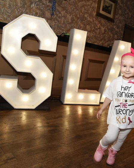 Isla Caton celebrating her birthday with family and friends before going to Spain for treatment.
