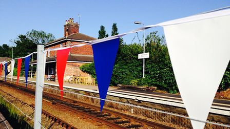 Bunting has been put up at stations along the route including Oulton Broad South station, pictured.