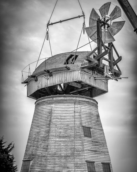 The mill's cap being removed for repair work. Photo: Andrew Conway