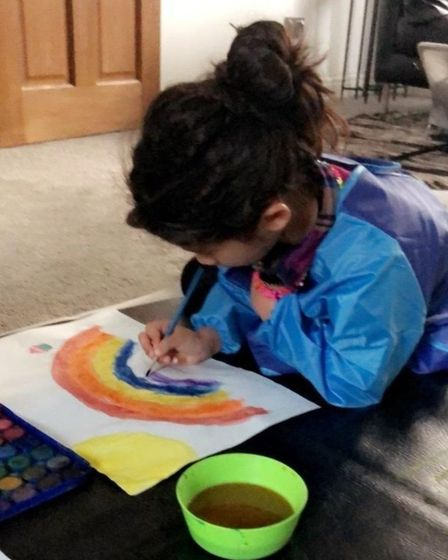 Safaa Patel, 5, painting as she works from home as Sandringham primary school has been closed due to