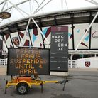 A view of an LED sign informing fans that the game is off outside the London Stadium, home of West H