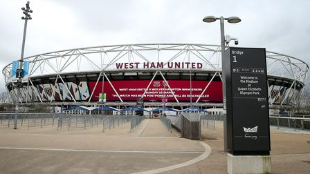 A view of a big LED screen informing fans of the postponement outside the London Stadium, home of We