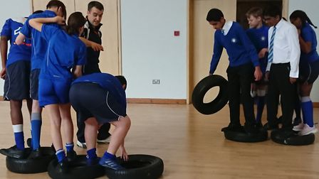 Royal Docks Academy pupils during one of the Royal Navy teamwork exercises. Picture: Kelly Clark
