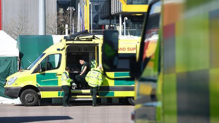 An ambulance crew await the first patients at the ExCel centre in London which is being made into the temporary NHS...