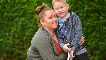 Oliver Whittington with his mum Clare. Picture: Nick Butcher.