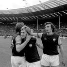 West Ham United's two-goal hero Alan Taylor (c) celebrates with teammates Billy Bonds (l) and Trevor