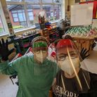 Teacher Lee Doe and Samantha Cadman are creating face shields from class room materials. PIcture: Le
