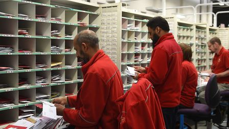 Workers sort letters and cards at a Royal Mail office. Picture: Joe Giddens, PA