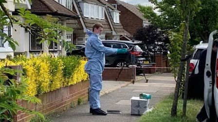 A forensics officer at the scene in Kerry Drive, Upminster. Picture: PA/Tom Pilgrim