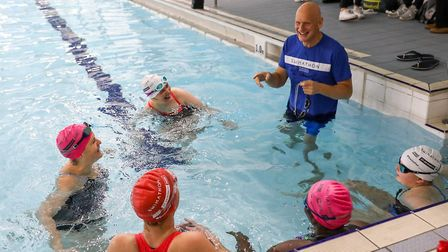 Swimathon President and Olympic gold medallist, Duncan Goodhew MBE, in the pool with swimmers (Pic:
