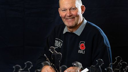 Steve Hammond with some of the 25cm high perspex figures which were made by injured veterans in the