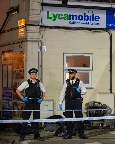 Police at the scene in Aldborough Road North, where a baby girl and a three-year-old boy were stabbe
