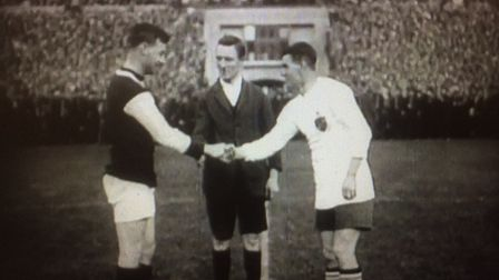 West Ham captain George Kay and Bolton's Joe Smith shake hands before the 1923 FA Cup final in a sti