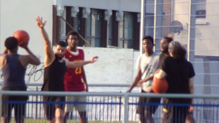 Youngsters play basketball in a court at Star Lane Park which has been closed. Picture: Submitted