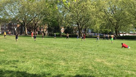 About 20 men play football in Central Park, East Ham, on Sunday, April 26. Picture: Submitted