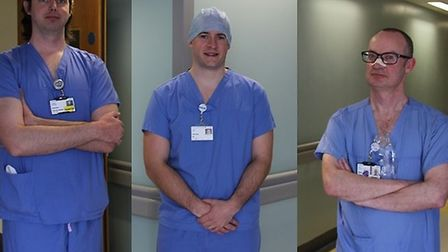 Appropriately socially-distanced operating department orderly, Lawrie Turner and operating departmen