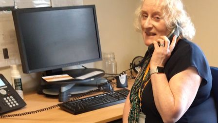 Julia Bryan has to make her calls by phone rather than in person because she has asthma and that put